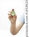 hand holding a vintage pocket clock 41658620