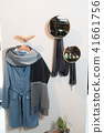 Stylish shelving with shoes and clothes in the apartments 41661756