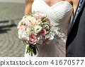 Wedding bouquet of flowers held by bride closeup. Pink flower 41670577