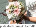 Wedding bouquet of flowers held by bride closeup. Pink flower 41670581