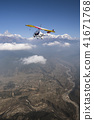 Ultralight plane and trike fly and Machapuchare 41671768
