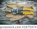Pair of safety gloves wire cutter on wooden board 41675974
