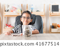 Asian little girl in smiling with the coin 41677514