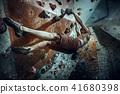 Free climber young man climbing artificial boulder indoors 41680398