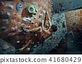 Free climber young man climbing artificial boulder indoors 41680429