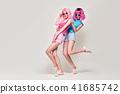 Two Girls Having Fun Dance. Pink Fashion Hairstyle 41685742