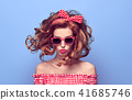PinUp Beauty Girl Blowing lips. Curly hairstyle. 41685746