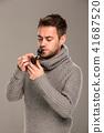 man lights a pipe 41687520