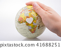 Hand holding a globe  with the map on it 41688251