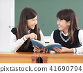 teenagers girl student studying in classroom 41690794
