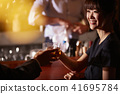 Men and women drinking at the bar 41695784