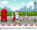 Boy walking his dog on the street 41696231