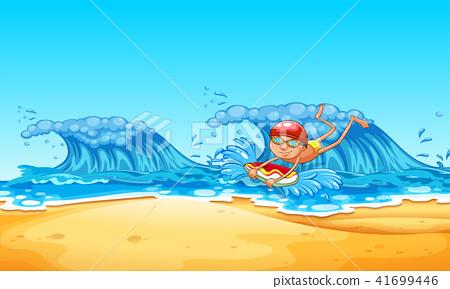 A Man Enjoy Bodyboarding at the Beach 41699446