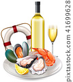 Meal of seafood with white wine 41699628