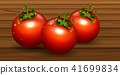 A Fresh Organic Tomato on Wooden Background 41699834