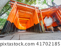 Worms eye view of Torii gates with blurred people 41702185