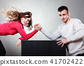 Arm wrestling challenge between young couple 41702422