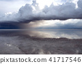Uyuni salt lake where rain clouds approach 41717546