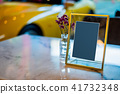 Glass frame label signboard with flower on desk 41732348