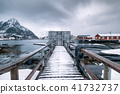 Wooden jetty and gate with fishing village house 41732737