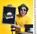 Excited Young Man Holding Summer Time Typography 41734742