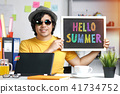 Young Man Holding Colorful Hello Summer Text 41734752