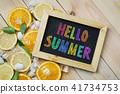 Colorful Hello Summer Text on Blackboard Orange 41734753