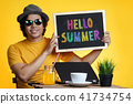Young Man Holding Colorful Hello Summer Text 41734754