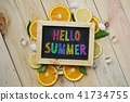 Colorful Hello Summer Text on Blackboard Orange 41734755