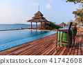 Gazebo wood and swiming pool near sea 41742608