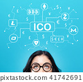 Cryptocurrency ICO theme with young woman  41742691