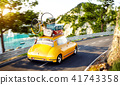 Cute little retro car with suitcases  41743358