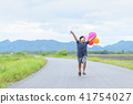 Happy boy running with balloon on the road, 41754027