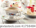 Cup of coffee served with cheesecake 41756484