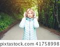 headphones, person, woman 41758998
