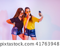 Teenage girls making selfie on smartphone 41763948