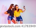 Teenage girls making selfie on smartphone 41763949
