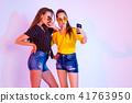 Teenage friends making selfie 41763950