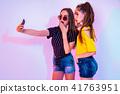 Teenage friends making selfie 41763951