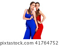 models posing in studio in bright overalls 41764752