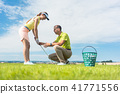 Young woman exercising the golf swing helped by her instructor 41771556
