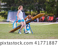 Dog on the seesaw obstacle in agility competition 41771887