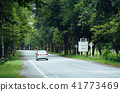 One car on the road with tree on background. 41773469