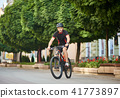 Male cyclist training in city center 41773897