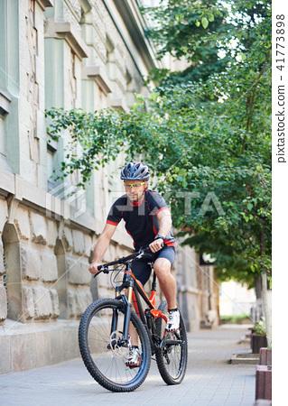 Sportsman training on bike in urban area 41773898