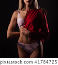 Blonde young woman in lace lingerie and red jacket 41784725
