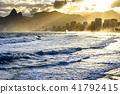Cloudy sunset at Ipanema beach with light rays 41792415