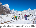 trekker are trekking on the snow mountain 41795307