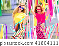 Two Girls with Colorful ribbons around. Outdoor 41804111
