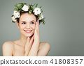 Happy young woman with cotton flowers and green leaves on banner 41808357